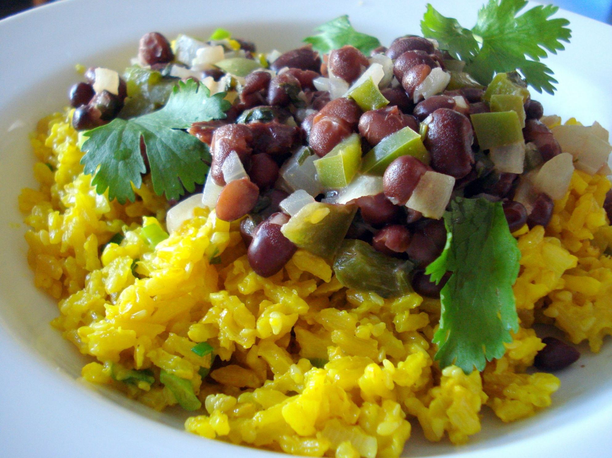 Black beans with yellow coconut rice