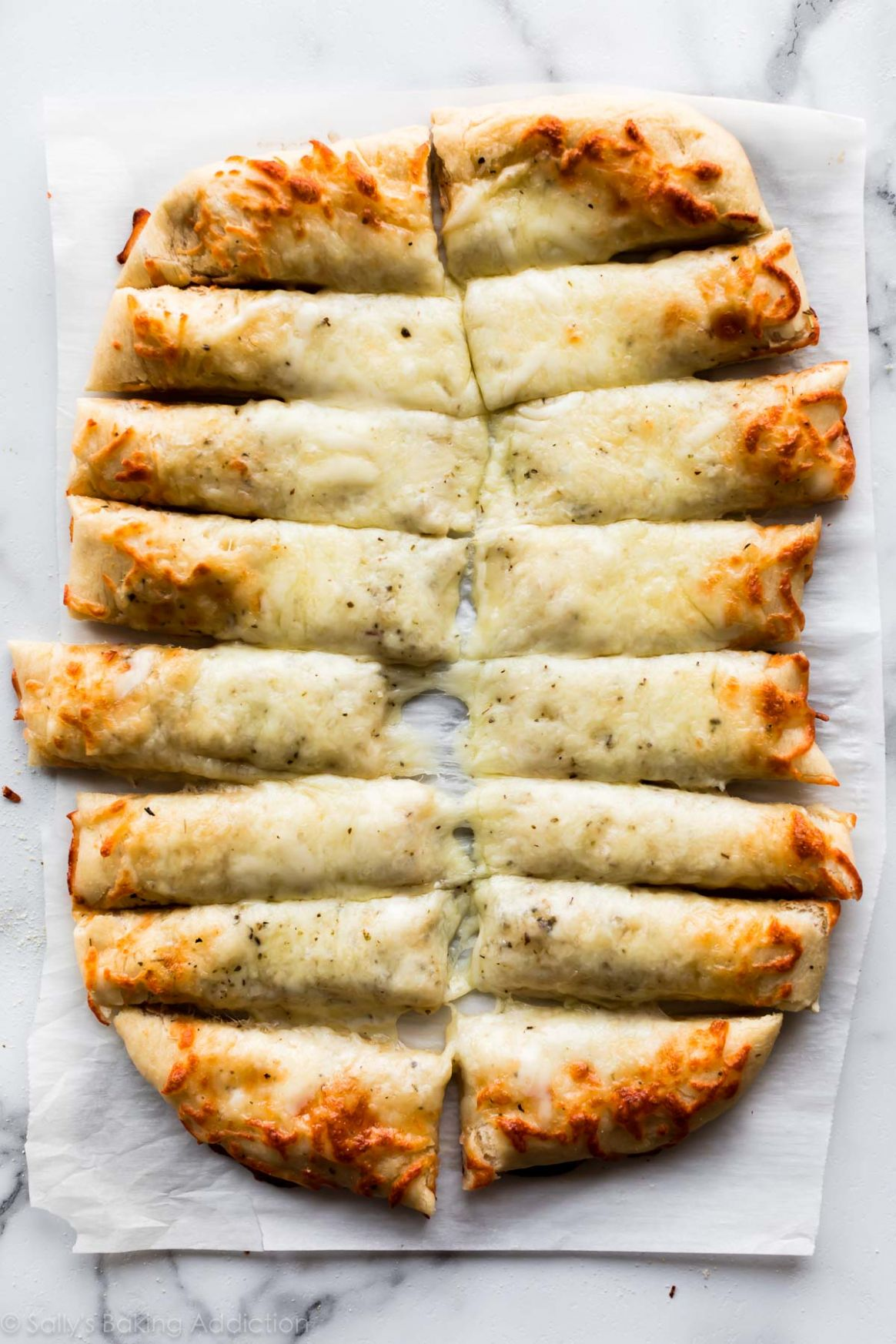Cheesy Breadsticks Made from Pizza Dough - Recipes Using Pizza Crust