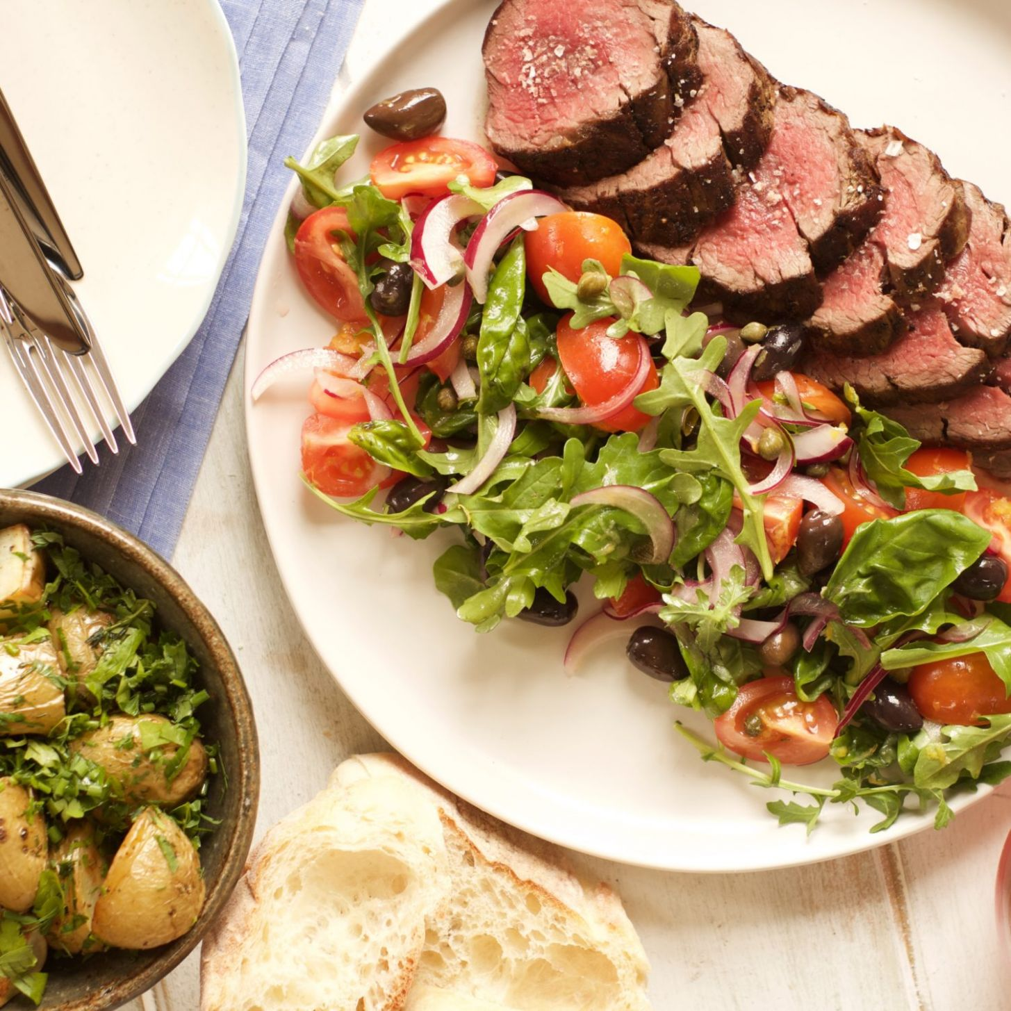 Eye Fillet with Mediterranean Salad and Herby New Potatoes - Recipes Beef Eye Fillet