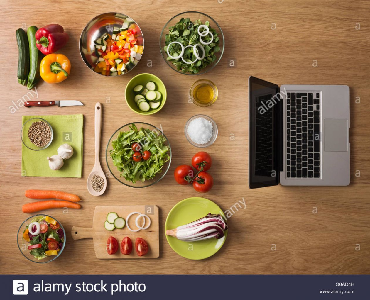 Online recipes concept with fresh vegetables, food ingredients and ..